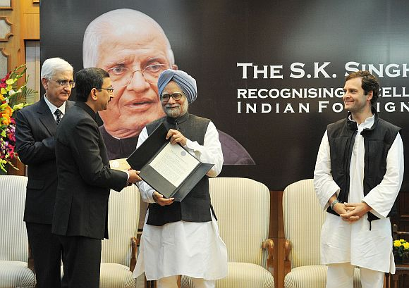 Dr Manmohan Singh presenting the S K Singh Award for recognising excellence in the Indian Foreign Service, to Tanmaya Lal. Also seen are External Affairs Minister Salman Khurshid and Congress Vice President Rahul Gandhi