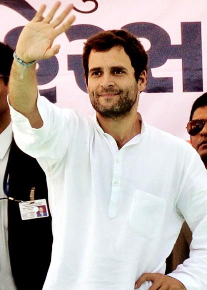 Rahul waves to his supporters at a rally in Gujarat