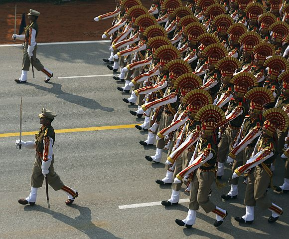 Soldiers march during the full dress rehearsal for the Republic Day parade