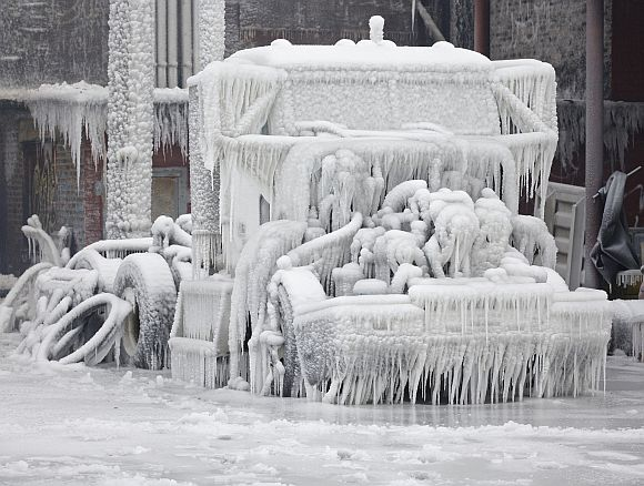 A truck is encased in ice, after a warehouse fire in Chicago on January 23. Fire department officials said it is the biggest fire the department has had to battle in years and one-third of all Chicago firefighters were on the scene at one point or another trying to put out the flames. An Arctic blast continues to grip the US Midwest and Northeast Wednesday, with at least three deaths linked to the frigid weather, and fierce winds made some locations feel as cold as 50 degrees below zero Fahrenheit (minus 46 degrees Celsius).