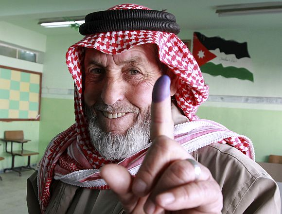 A man shows his ink-stained finger after voting at a polling station in Amman January 23. Jordanians voted on Wednesday in their first parliamentary elections since the Arab Spring revolts, but a boycott by the main Islamist party will ensure no repeat of an Egypt-style revolution via the ballot box
