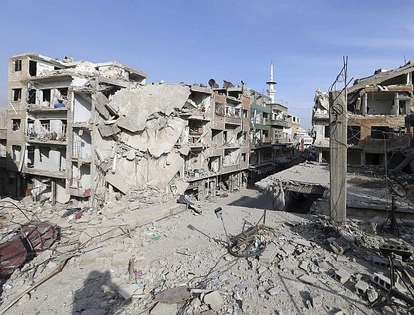 Buildings destroyed by Syrian air force air strikes are seen in Duma neighbourhood, Damascus