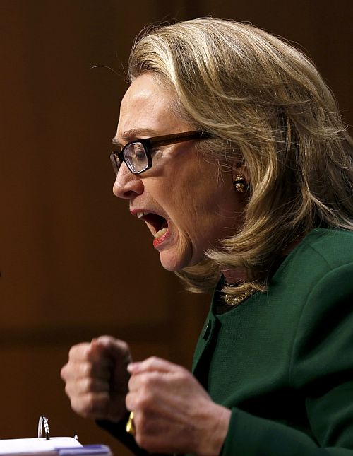 US Secretary of State Hillary Clinton pounds her fists as she responds to intense questioning on the September attacks on US diplomatic sites in Benghazi, Libya, during a Senate Foreign Relations Committee hearing on Capitol Hill in Washington