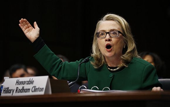 Clinton pounds on her table while testifying