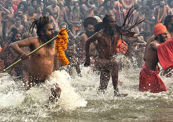 Naga Sadhus take a dip on the first bathing day.