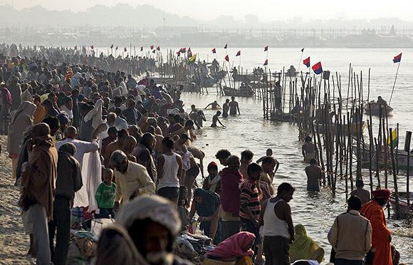 Pilgrims on the banks of Ganga take a dip during the 2001 Maha Kumbh Mela in Allahabad