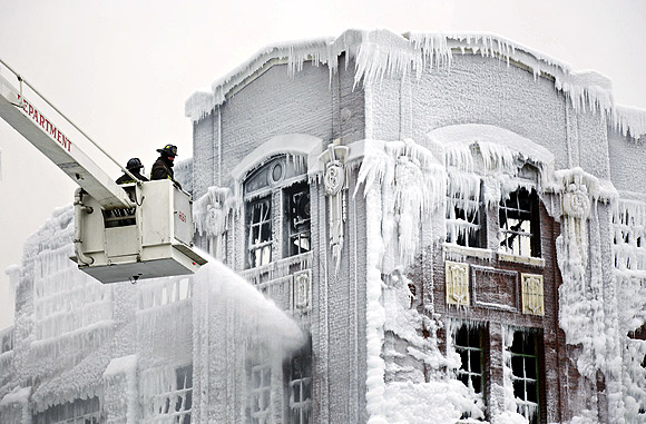 STUNNING PIX: Water freezes as firefighters battle blaze