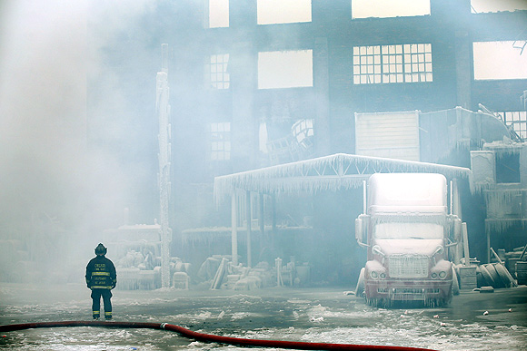 Water freezes as firefighters battle blaze
