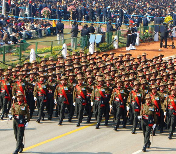 Assam Rifles marching contingent passes through the Rajpath during the 64th Republic Day parade