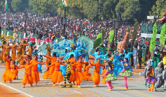 Schoolchildren perform at Rajpath during the 64th Republic Day parade in New Delhi