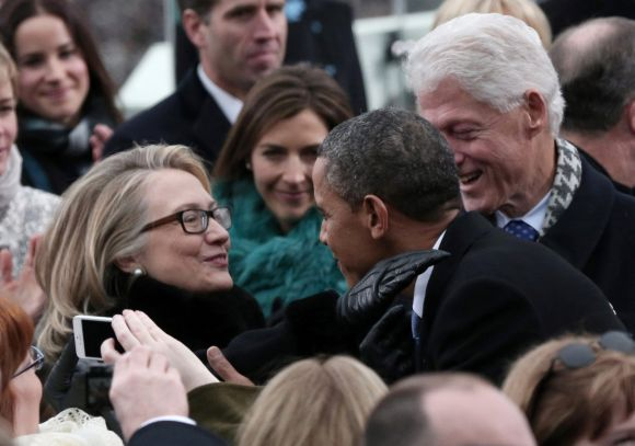 US President Barack Obama greets Secretary of State Hillary Clinton and former president Bill Clinton in Washington, DC