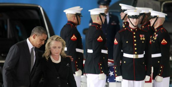 Barack Obama and Hillary Clinton participate in a transfer ceremony of the remains of US ambassador to Libya Chris Stevens and three other Americans killed in Benghazi, at Washington, DC