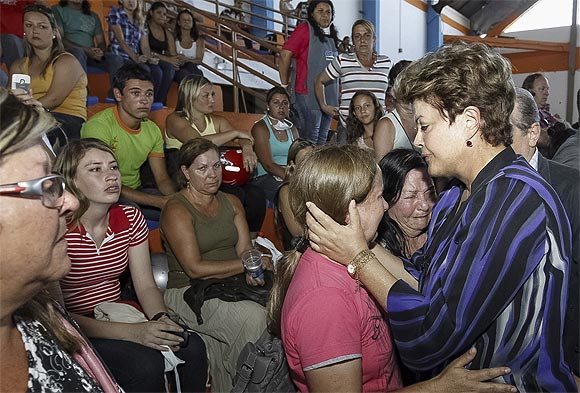 Brazil's President Dilma Rousseff consoles relatives of the victims