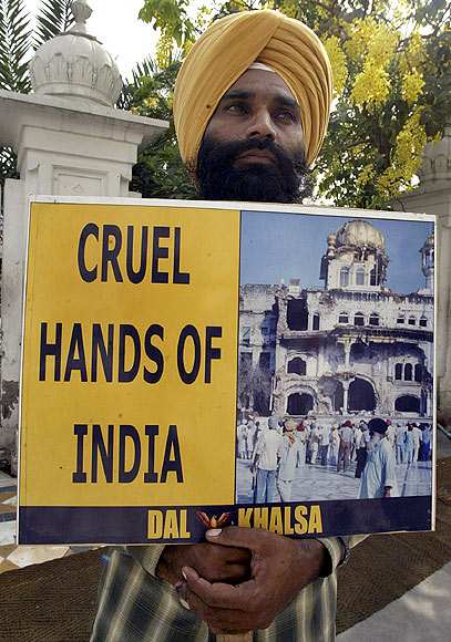 An activist from the Dal Khalsa, a radical Sikh organisation, holds a placard during the 24th anniversary of Operation Blue Star, outside the Golden Temple in Amritsar.