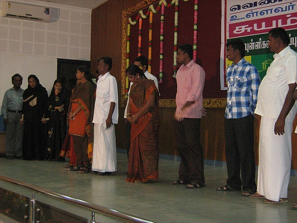 Participants present themselves on the stage