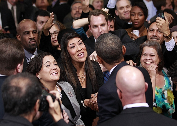 Obama greets members of the audience after delivering his remarks