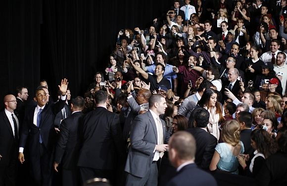 Obama (second left) greets members of the audience after delivering his remarks on immigration reform at Del Sol High School in Las Vegas