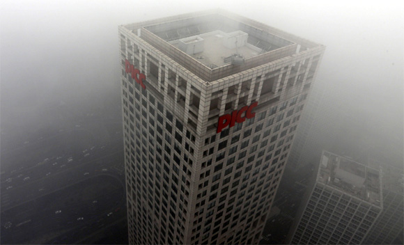 Buildings and cars are pictured in Beijing's central business district