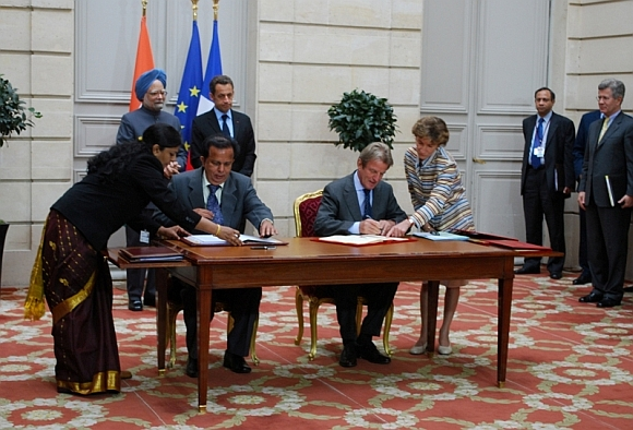 Then ISRO chairman G Madhavan Nair, left, signs an agreement with his French counterpart. Dr Singh and then French president Nicolas Sarkozy can also be seen.
