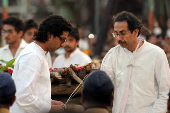 Raj Thackeray performs the last rites at uncle Bal Thackeray's funeral along with cousin Uddhav at Shivaji Park in Mumbai