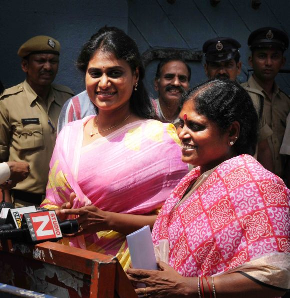 Jagan's mother Vijayamma (right) and sister Sharmila speak to the media outside Hyderabad's Chanchalguda prison