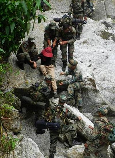 Army personnel rescue a stranded person in rain-ravaged Uttarakh