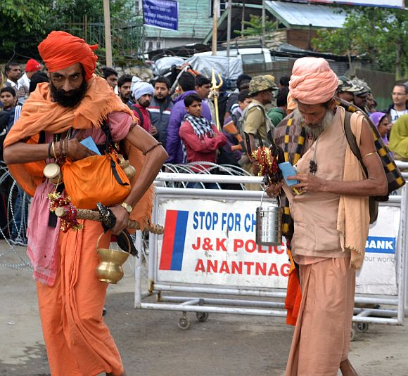 Two Sadhus begin their journey to the cave shrine
