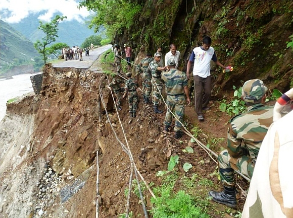 Two bridges being launched by the army for move of light vehicles in Uttarkashi