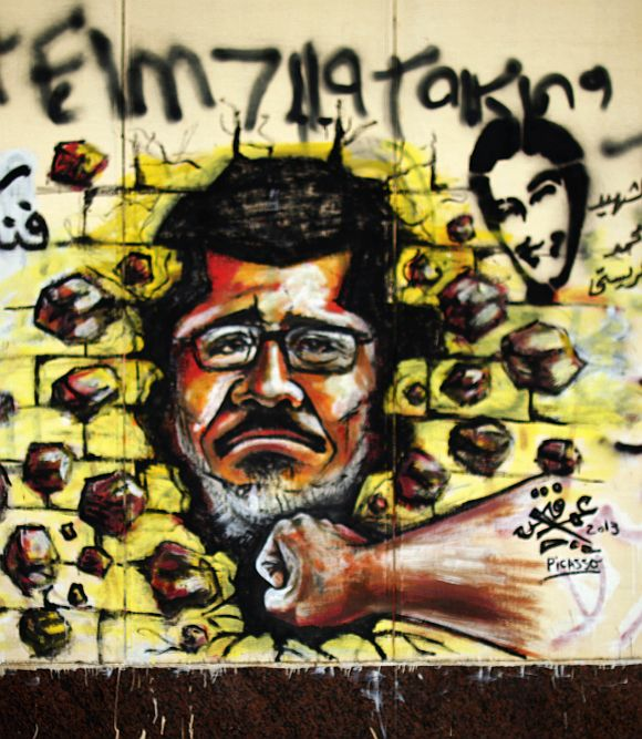 A graffiti depicting Egypt's President Mohamed Mursi on a wall of the Presidential Palace in Cairo