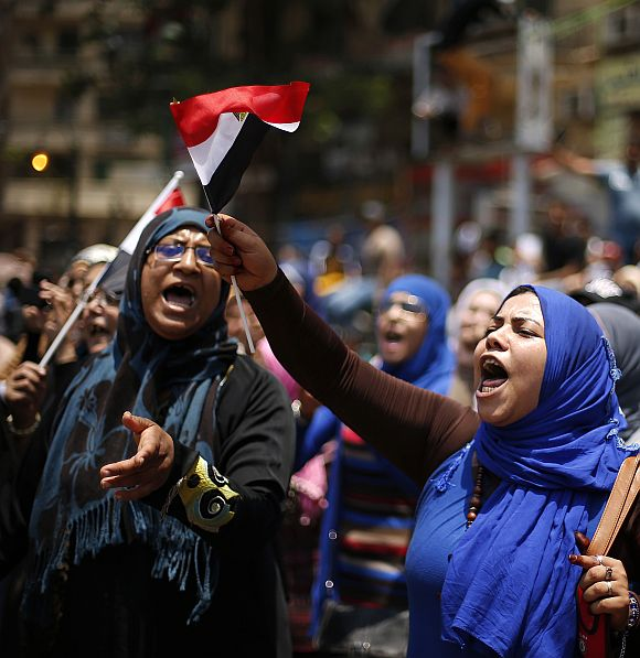 Protesters, opposing Egyptian President Mohamed Mursi, take part in a protest demanding Mursi to resign at Tahrir Square in Cairo
