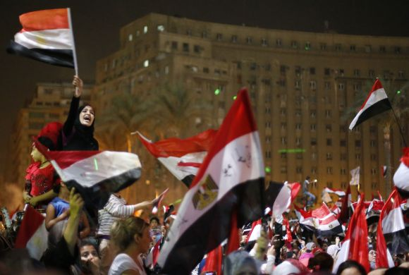 Protesters, who are against Morsi, react in Tahrir Square in Cairo