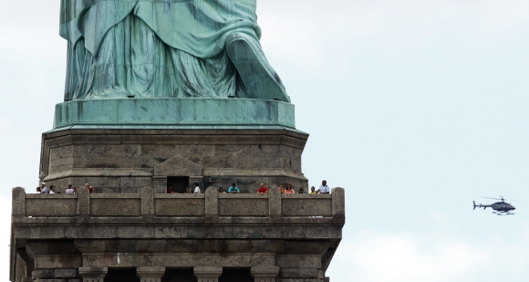 People visit the Statue of Liberty during the reopening ceremony in New York