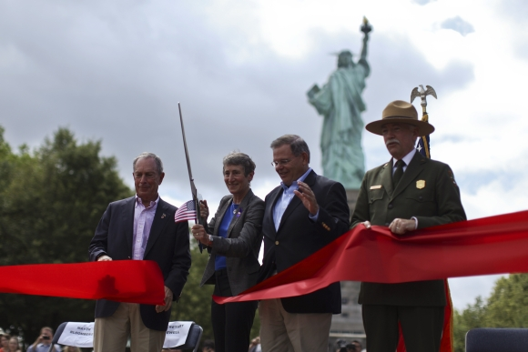 Secretary of the Interior Sally Jewell cuts the ribbon next to New York City Mayor Michael Bloomberg, US Senator Robert Menendez and Director of the United States National Park Service Jonathan B Jarvis at the reopening ceremony in New York