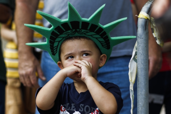 A child attends the cremony in New York