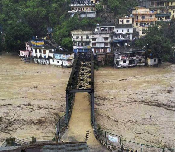 A bridge submerged in the flooded water of the river Ganga