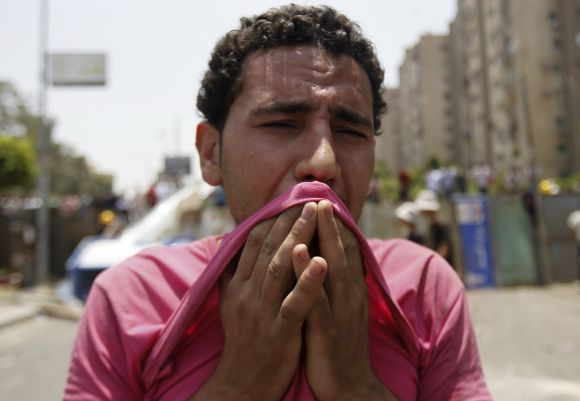 A member of Muslim Brotherhood reacts at Republican Guard headquarters in Nasr City
