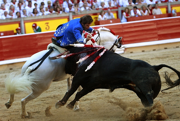 Bulls hit the streets in Spain, everyone's on the run