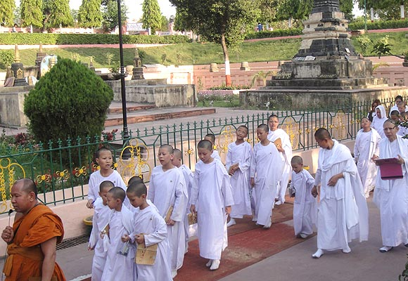 Child monks in white robes at the Mahabodhi temple in Bodh Gaya