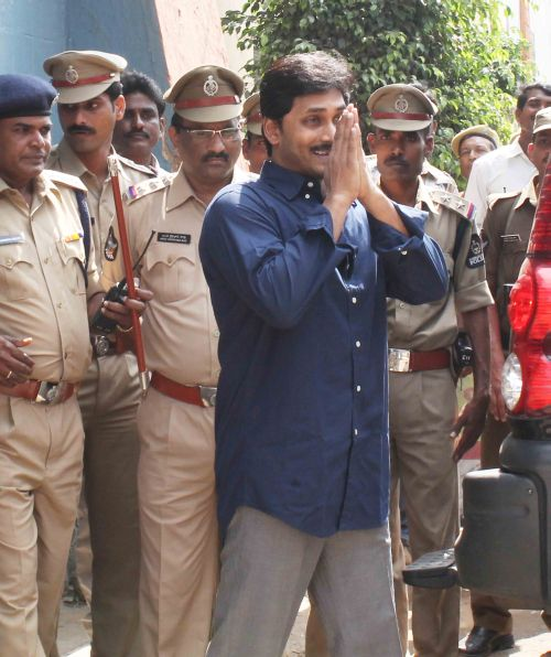 YSR Congress president Jaganmohan Reddy steps out of jail to appear in a CBI court amid tight security in Hyderabad