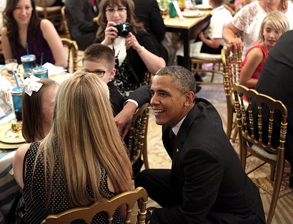 bama greets guests at the second annual 'kids' state dinner