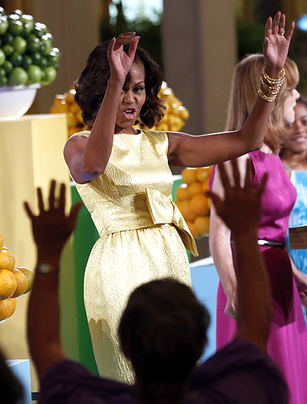 Michelle Obama joins in a wave during the 'kids' state dinner'