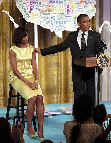 Obama addresses guests at the 'kids' state dinner', as wife Michelle watches on