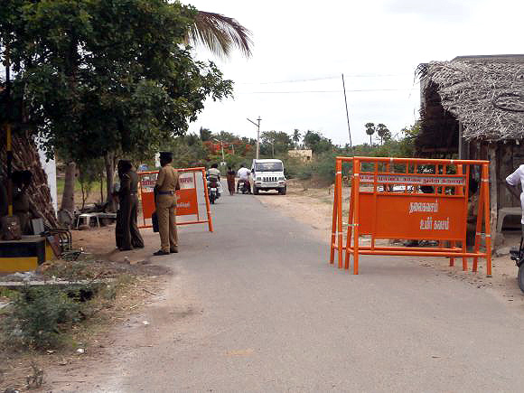 A police barricade on the road leading to Ilavarsan's village
