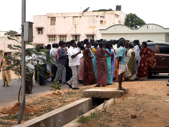 Ilavarasan's relatives outside the Dharmapuri Medical College Hospital in Tamil Nadu on Wednesday, waiting for news of his second post-mortem