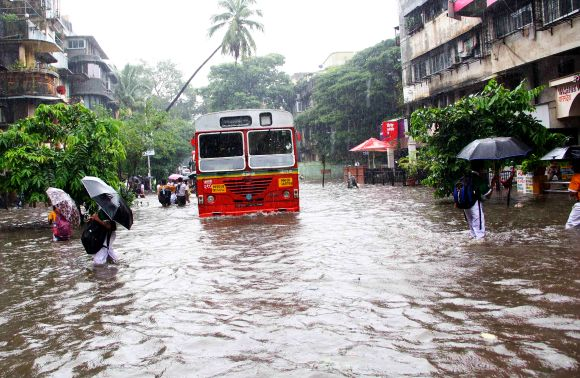 Mumbai slows down as rains hit road, rail traffic