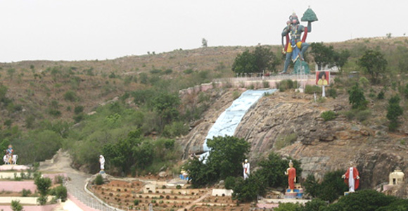 A hill in Prashanthi Nilayam with statues of Hanuman, Krishna, Shirdi Sai Baba, Shiva, Buddha, Christ, Zarathustra