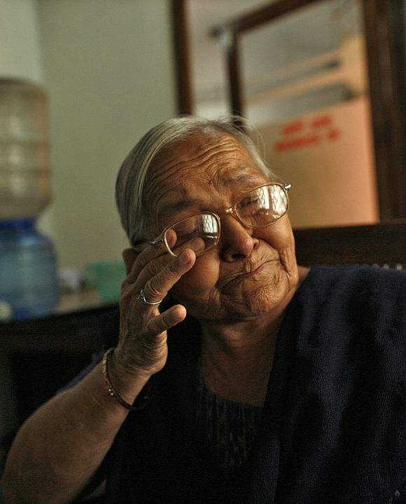 Kamla Devi, an employee who has served for 30 years, cries as she talks about her career, inside the Central Telegraph Office in New Delhi