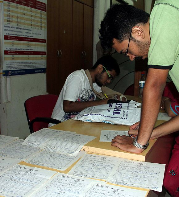 A person fills out his last telegram at a telegraph centre in Mumbai