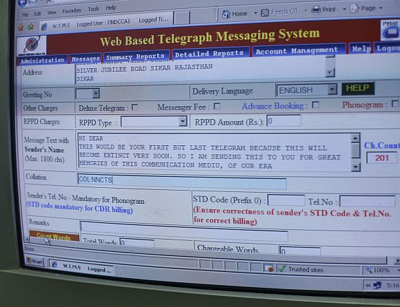 A computer screen shows a telegram message inside the central Telegraph office in New Delhi