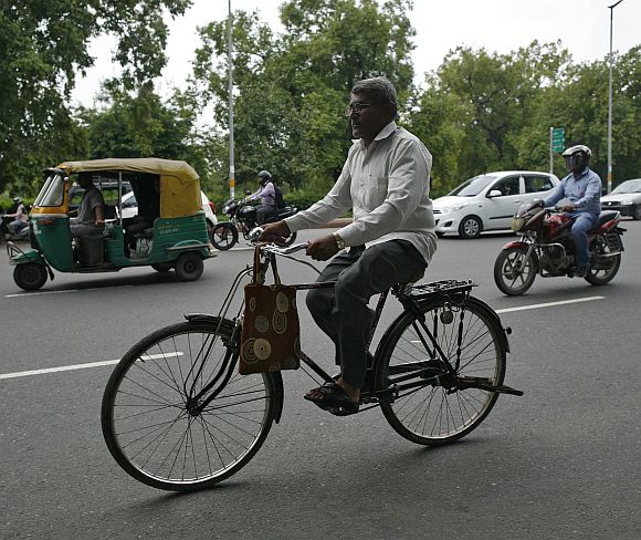 Messenger Om Dutt, 56, rides a bicycle as he delivers telegrams in New Delhi